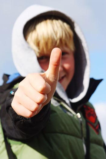 Portrait Of Boy Gesturing Thumbs Up
