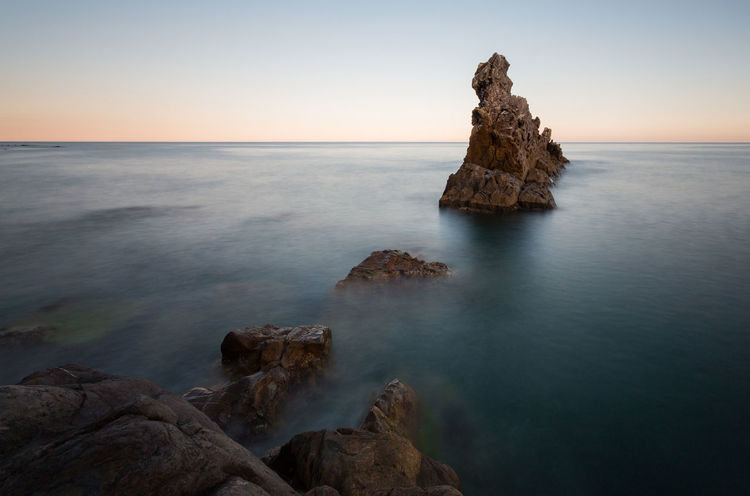 Sea Rock - Object Sunset Horizon Over Water Nature Beauty In Nature Water Summer Tranquility Landscape Outdoors Scenics Beach No People Sky Horizon Day City Rocks Stones Long Exposure Italy🇮🇹 Beauty In Nature Travel Destinations Cliff