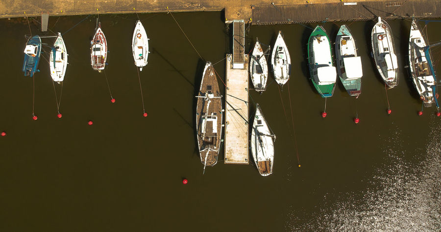 Sail boat on the marina from above Ship Sailing Sailboat Marina River Harbour View Fromabove Birdeyeview. Gdansk Coastline Drying Hanging Multi Colored Variation