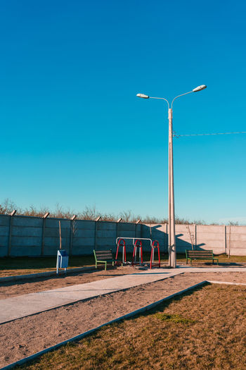 Sky Clear Sky Nature Day Blue Copy Space Sunlight No People Street Light Lighting Equipment Water Outdoors Land Street Field Environment Non-urban Scene Barrier Scenics - Nature