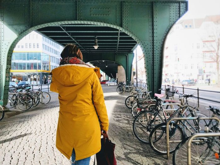 Rear View Transportation Bicycle Real People Men Lifestyles One Person Traditional Clothing City Outdoors Day Adults Only People Adult Yellow Color Green Color Arch Ubahn Berlin Berliner Ansichten Urban Geometry Neighborhood Map The Street Photographer - 2017 EyeEm Awards Paint The Town Yellow #FREIHEITBERLIN
