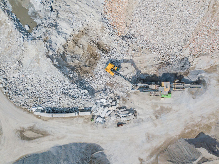 High angle view of earth mover digging land