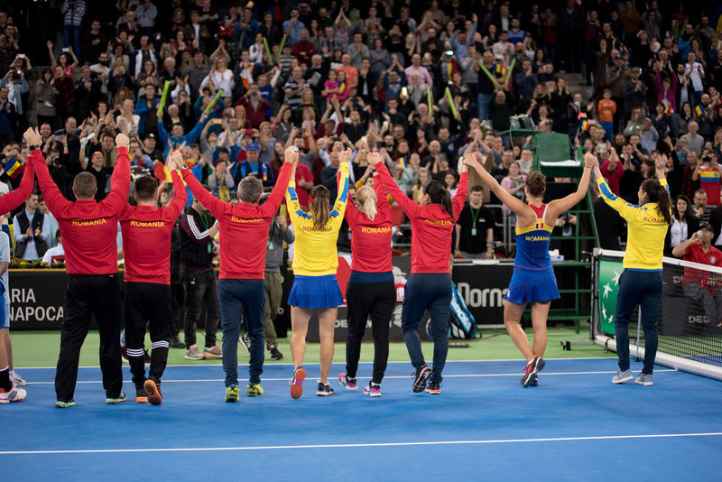 CLUJ NAPOCA, ROMANIA - FEBRUARY 11, 2018: Woman tennis players of Romania celebrating the victory after they won the tennis Fed Cup against Canada, general score 3:1 Celebration Happiness National Team Romania Romanian  Tennis Tennis Player Trophy Cheerful Crowd Crowd Of People Crowded Euphoria Fans Large Group Of People Sport Sport Women Sportswear Supporter Tennis 🎾 Tenniscourt Tribune Victory Winner Women