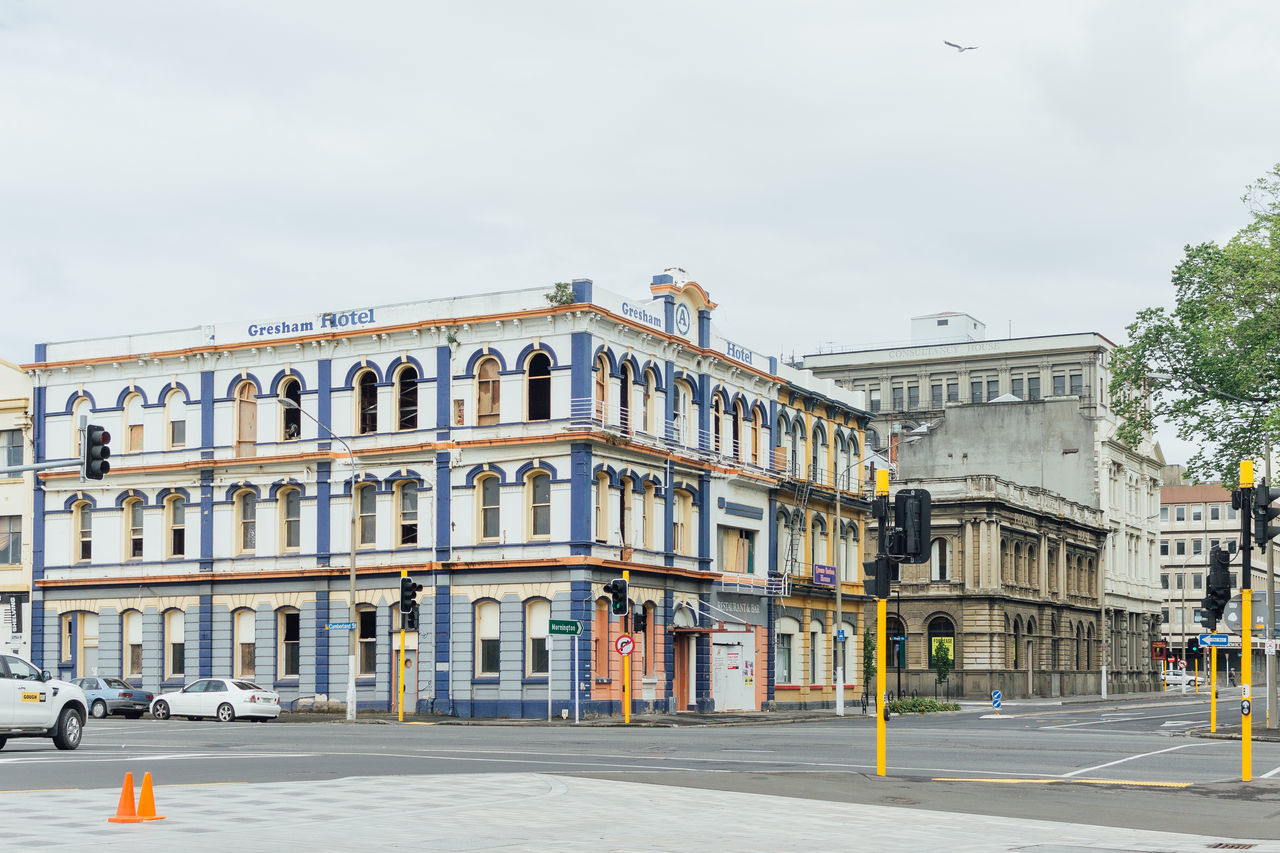 building exterior, architecture, street, built structure, outdoors, city, sky, road, day, no people