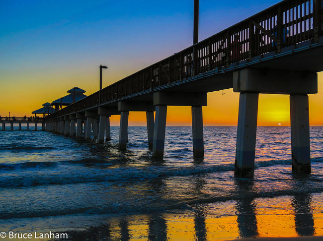 Sunset by Fort Myers beach Pier Fort Myers Beach Pier Architectural Column Architecture Beach Beauty In Nature Bridge - Man Made Structure Built Structure Connection Day Gulf Of Mexico Horizon Over Water Nature No People Outdoors Scenics Sea Sky Sunlight Sunset Transportation Water Waterfront