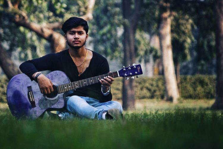 Rahul - Abshine photography Rahul Abshine Abshine_photography Canon Canon1200d Canonphotography Delhi Photography Photographyoftheday Picoftheday DSLR Camera Guitar Music Plucking An Instrument Guitarist Musical Instrument Playing Arts Culture And Entertainment Musician Outdoors Sitting Grass