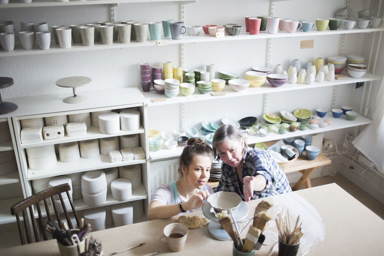 Portrait of women sitting in shelf