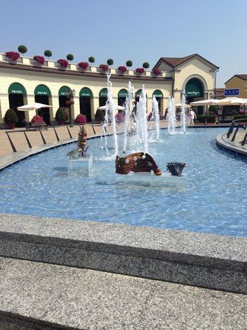 Serravalle Designer Outlet Serravalle Designer Outlet Serravalle Scrivia Water Architecture Built Structure Nature Day Building Exterior Sunlight Fountain Sky Arch Transportation Outdoors City Reflection Clear Sky Flowing Water