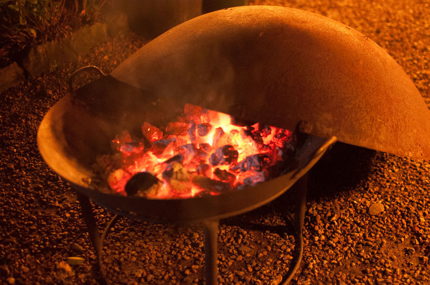 Hot smoking brazier, with lid resting on the brazier Brazier Burning Close-up Flame Food Food And Drink Heat - Temperature Night No People Orange Color