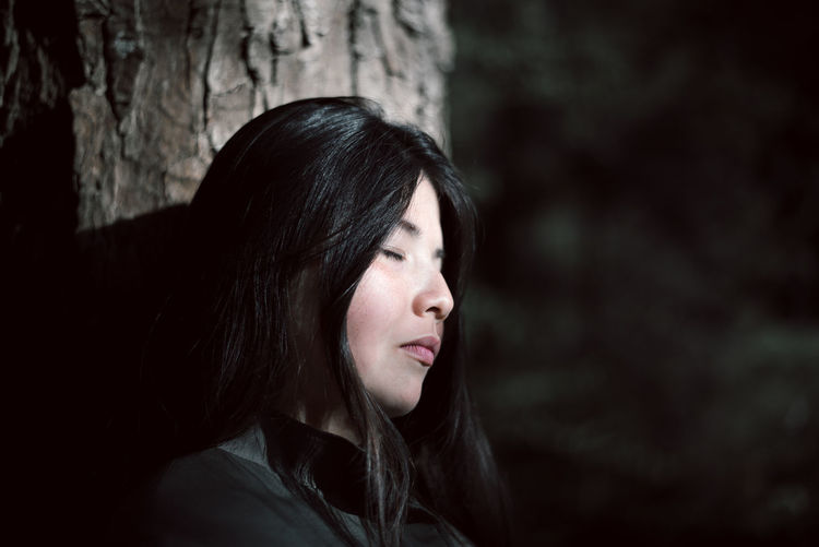 Darkness and light Adult Adults Only Asian  Beautiful Woman Black Hair Close-up Darkness And Light Day Face Focus On Foreground Headshot Human Body Part Human Face Lifestyles One Person Outdoors People Portrait Real People Tree Woman Women Young Adult Young Women This Is Natural Beauty