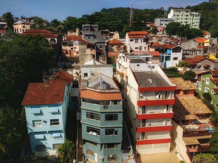 Colourful apartment blocks and houses nested in an urban mountain forest. Architecture Building Exterior Built Structure Residential Building House Outdoors No People City Day Cityscape Town Ecology Nature Meets Urban Capital Cities  Brazilian Urban Jungle Latin America South America Mountain Forest High Angle View Aereal View Tropical Scenics Travel Destinations
