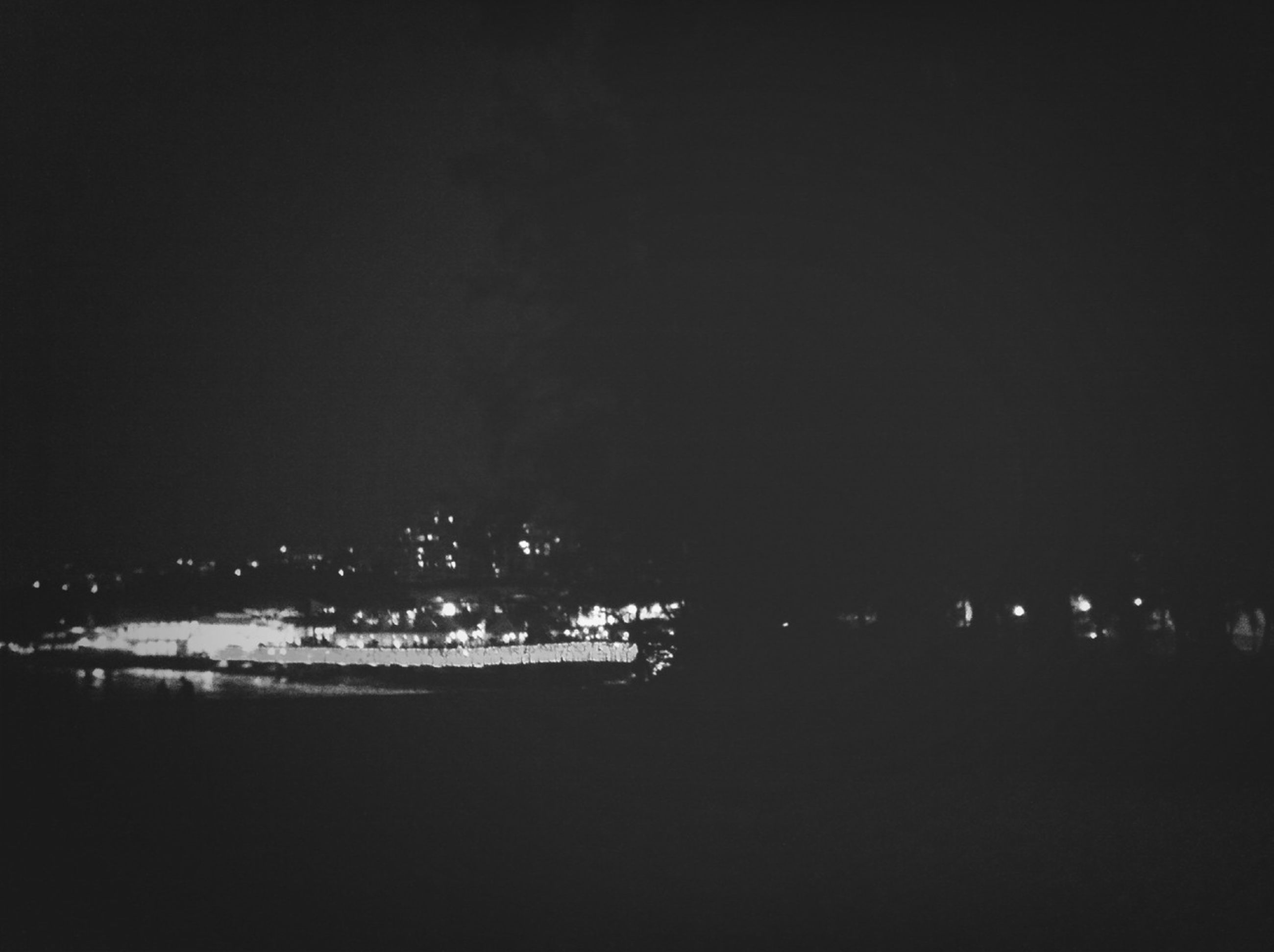 night, water, illuminated, copy space, sea, clear sky, nautical vessel, dark, river, tranquility, sky, waterfront, transportation, tranquil scene, nature, built structure, scenics, beach, outdoors, architecture