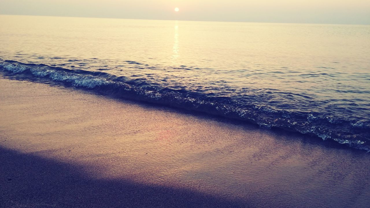 sea, water, nature, scenics, beauty in nature, tranquil scene, beach, tranquility, sunset, sun, idyllic, horizon over water, sand, outdoors, no people, sky, wave, day