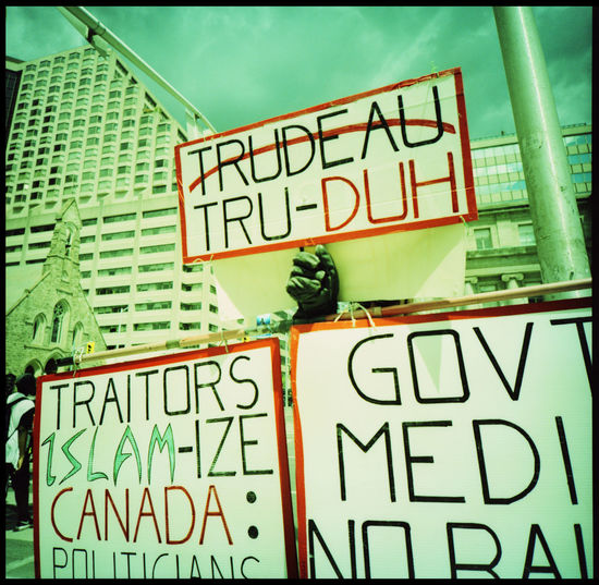 Trudeau or not Trudeau Analogue Photography Architecture Canada Demonstrations  Lomography Media Medium Format Naysayer Northamerica Outdoors Politics Protest Signs Streetphotography Toronto Trudeau Trudeaumania Urban Urbanphotography Xpro