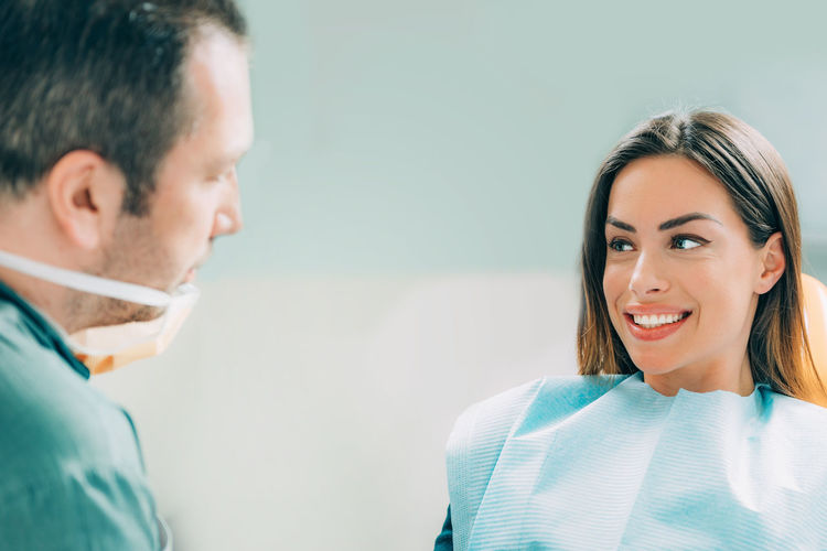 Smiling patient looking at dentist