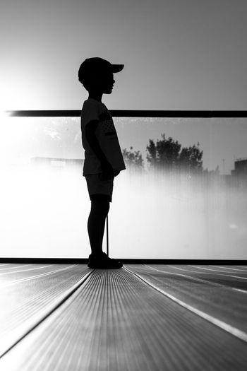 Full length of silhouette woman standing against sky