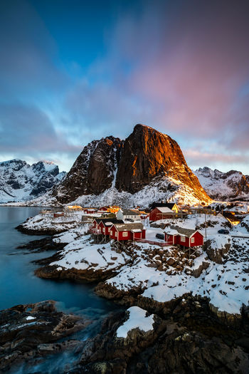 Arctic Sunrise II Hamnøy- Norway The oldest fishing village in the stunning Lofoten archipelago is small, but unbelievably beautiful. It is considered to be one of the most picturesque villages in the municipality of Moskenes, which is also a popular tourist destination due to its scenic and unspoiled nature. Arctic Sunrise Arctic Hamnøy Hamnoy Norway Norway🇳🇴 Norway Nature Sunrise Sunrise_sunsets_aroundworld Sunrise_Collection No People Outdoors Snowcapped Mountain Environment Beauty In Nature Scenics - Nature Cold Temperature Mountain Winter Snow Sky Cloud - Sky Nature