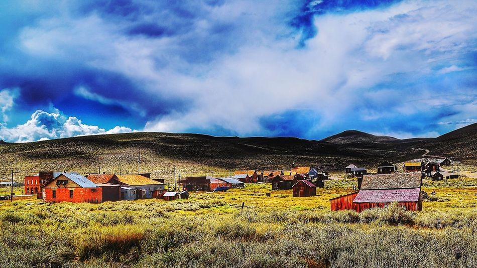 Bodie ca Cloud - Sky Sky Building Exterior Architecture Built Structure Land Nature Building Field Outdoors Plant No People Day House Residential District Environment Beauty In Nature Mountain Landscape Sunlight