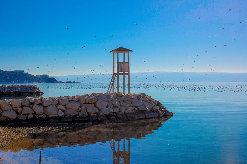 Christmas in Croatia :) Beauty In Nature Blue Built Structure Clear Sky Croatia Dalmatia Day Nature No People Outdoors Sea Sea And Sky Seagulls Sky Stobreč Stone Tranquil Scene Tranquility Tranquility Water