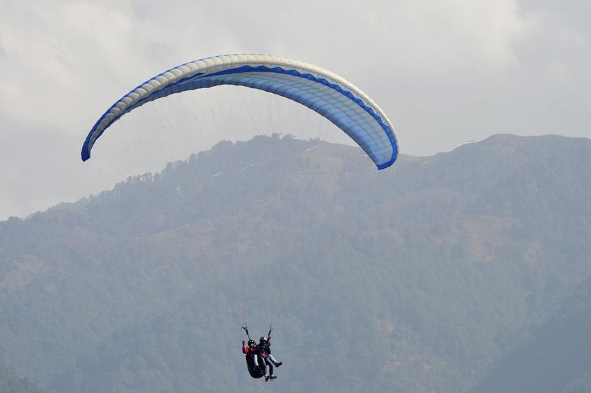 Parachute Paragliding Adventure Extreme Sports Flying Leisure Activity Outdoors Real People Sky Mountain View Clouds Cold Weather Extreme Sport EyeEmNewHere Miles Away Flying High