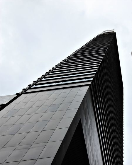 Singapore #urbanana: The Urban Playground Architecture Building Building Exterior Built Structure City Cloud - Sky Day Low Angle View Modern Nature No People Office Office Building Exterior Outdoors Pattern Sky Skyscraper Tall - High Tower Travel Destinations
