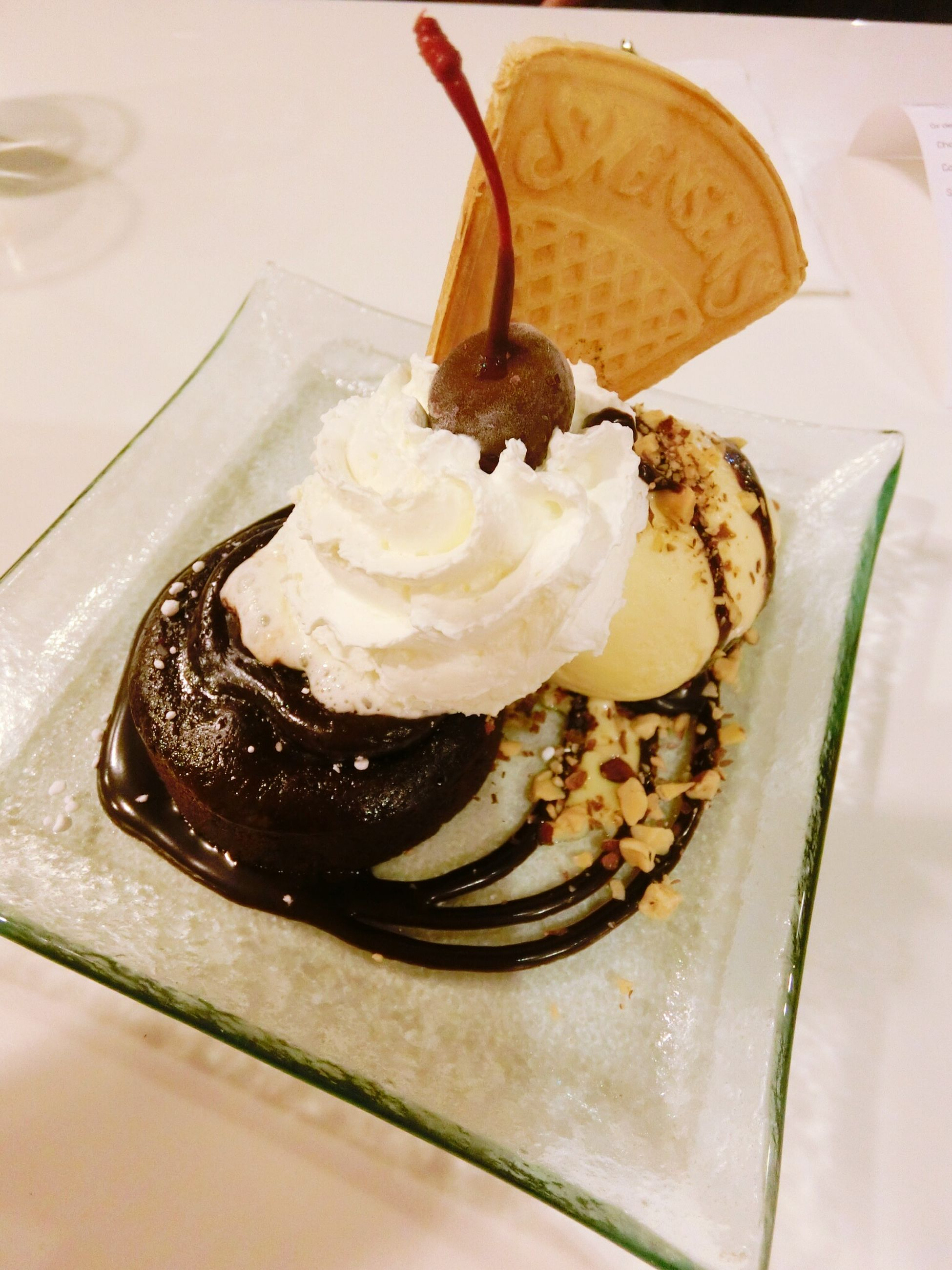 food and drink, food, freshness, indoors, sweet food, dessert, ready-to-eat, indulgence, still life, plate, unhealthy eating, cake, temptation, close-up, table, serving size, high angle view, chocolate, ice cream, fork