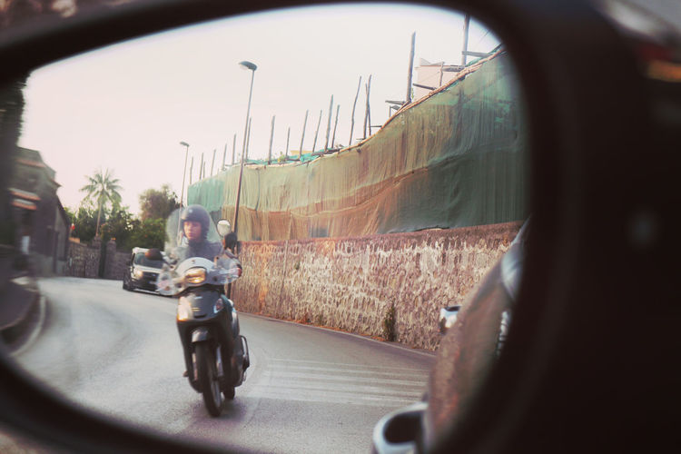 Road Trip... Day Fish-eye Lens Focus On Background Headwear Helmet Journey Land Vehicle Lifestyles Men Mode Of Transport Motorcycle One Person Outdoors People Public Transportation Real People Road Scooter Side-view Mirror Sky Train - Vehicle Transportation Travel