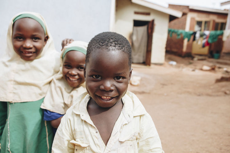 Africa African Barefoot Boy Boys Cheerful Child Childhood Children Day Dirt Friends Friendship Girls Ground Happiness Kids Looking At Camera Muslim Outdoors Portrait School Smiling Students Togetherness
