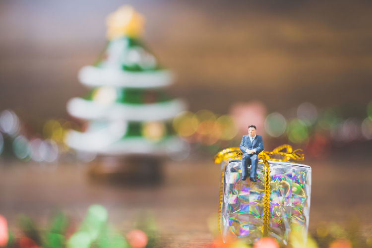 Background Box Celebrating Celebration Christmas Closeup Colorful Concept Couple Creative Creativity Decor Decoration Decorative Design Event Festive Gift Gold Holiday Human Items Love Macro Miniature Object Package Paper People person Present Red Ribbon Season  Surprise Teamwork Toy White Wooden Xmas