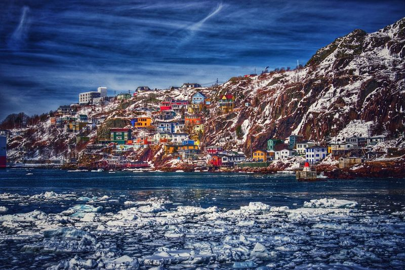 Dramatic tones of The Battery Water Sky Outdoors Nature Rock - Object Sea Beauty In Nature Day Cloud - Sky Vacations No People Mountain Vibrant Color Harbour