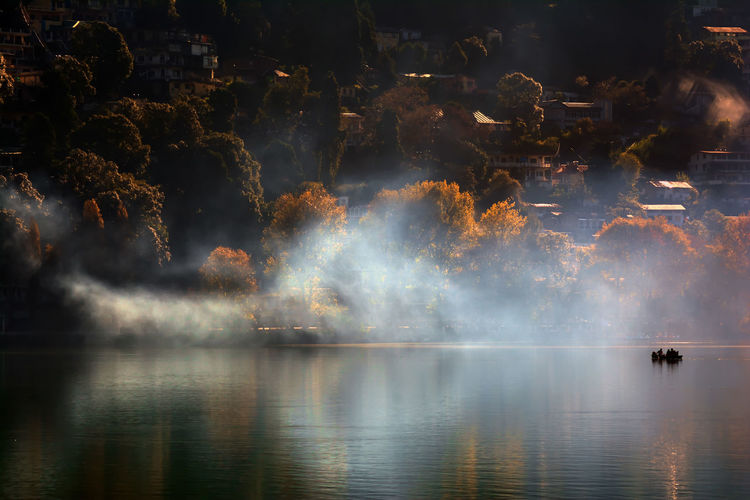 Early Morning.. Boating Golden Tree Beauty In Nature Boat Early Morning Fog Lake Lake View Lake Views Motion Nature Reflection Smoke - Physical Structure Sun Rays Wather