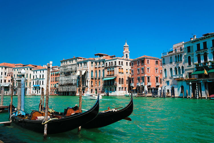 Adult Architecture Building Exterior Canal Day Gondola Gondola - Traditional Boat Gondolier Nautical Vessel Occupation Outdoors People Transportation Travel Destinations Water