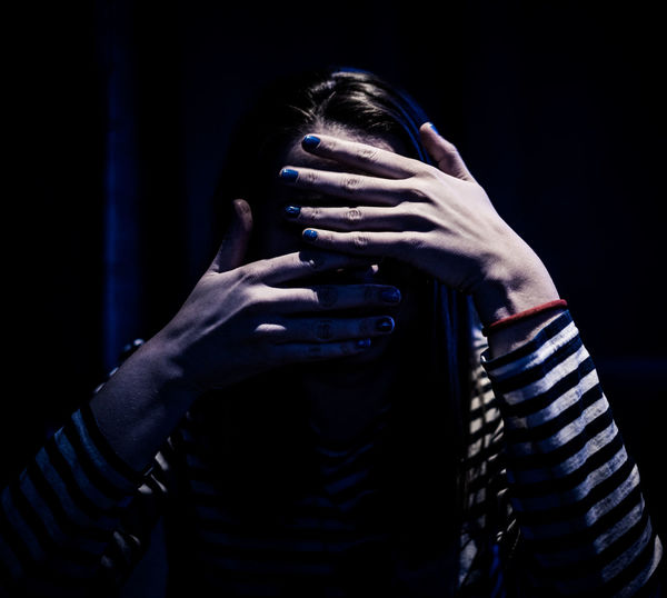 Midsection Of Woman Covering Face With Hands