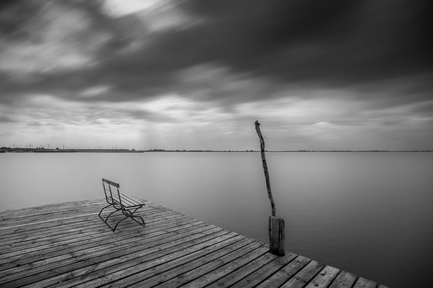 Cloud - Sky Water Sky Beauty In Nature Scenics - Nature Tranquility Wood - Material Tranquil Scene Pier Lake Nature Overcast Storm No People Jetty Storm Cloud Outdoors Day Wood Paneling
