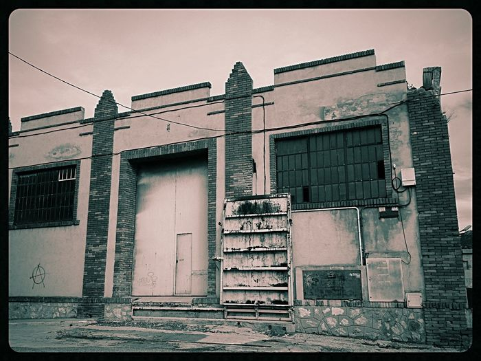 Barren hopes for the wicked. Mobilephotography XPERIA Blackandwhite Monochrome Old Places On The Road Abandoned Pixlr Architecture Exploring Creepy Monochrome World No People Lumiocam Rusted Rustlovers Doorcollector