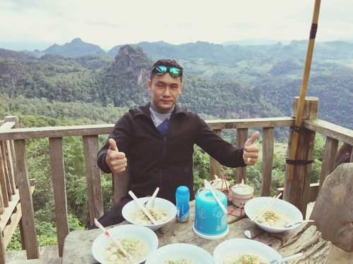 One Person Food And Drink Front View Mountain Real People Sunglasses Looking At Camera