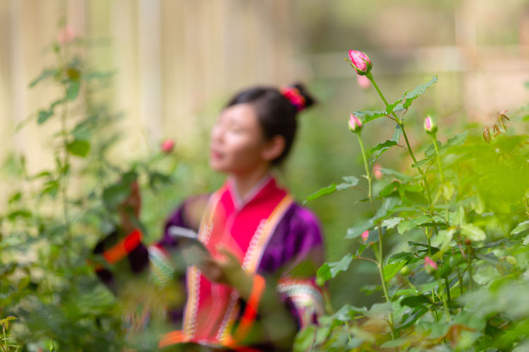 Plant Growth One Person Flowering Plant Flower Nature Real People Leisure Activity Child Selective Focus Lifestyles Females Beauty In Nature Childhood Women Day Freshness Fragility Outdoors