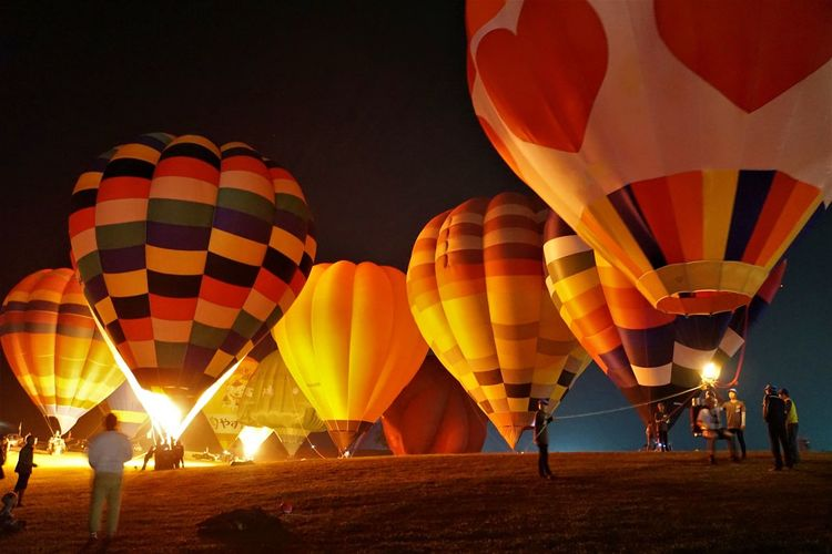 Hot air balloons on ground at night