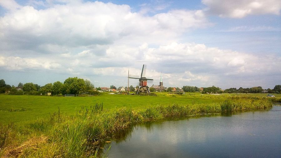 Agriculture Alternative Energy Cloud Cloudy Depth Of Field Distant Environmental Conservation Farm Field Grass Holland Journey Landscape No People Outdoors Relaxing Moments Rural Scene Selective Focus Sky Tranquil Scene Tropical Climate Wind Turbine Windmill First Eyeem Photo