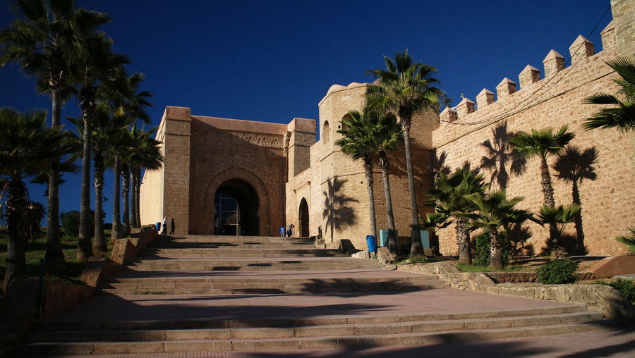 Gate Mission Impossible Morocco Old Town Rabat Sunny Walled City Blue Sky Elaborate Film Location Grand Entrance Palm Trees Ramparts Sandstone