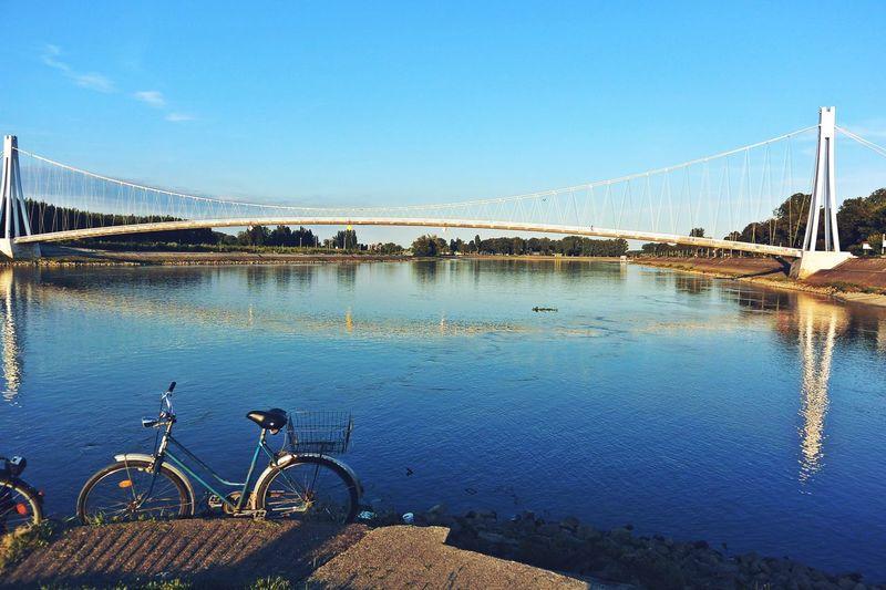 Architecture Baranja Bicycle Blue Bridge City Croatia Drava Europe Footbridge No People Osijek River Sunny Day Water Water Reflection