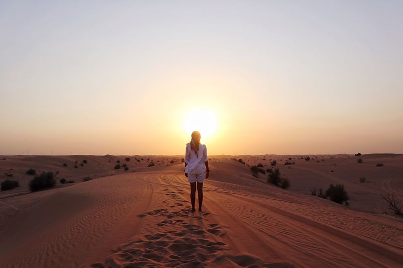 Lost In The Landscape Desert Sand Sunset Nature Arid Climate Sand Dune Real People Scenics Landscape Tranquil Scene Sunlight One Person Beauty In Nature Full Length Rear View Standing Sky Sun Tranquility Dubai UAE Travel Outdoors