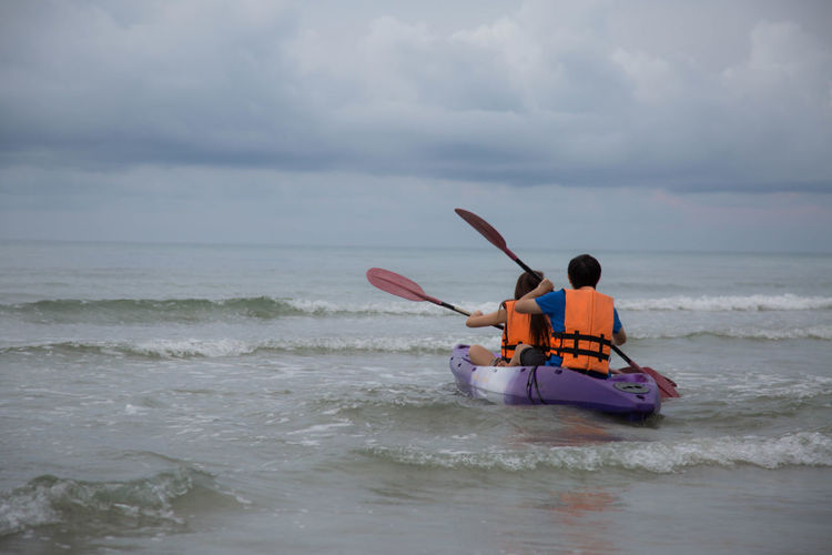 Cloud - Sky Cloudy Horizon Over Water Kayaking Leisure Activity Lifestyles Men Motion Nature Sea Sky Surf Togetherness Vacations Water Waterfront Wave