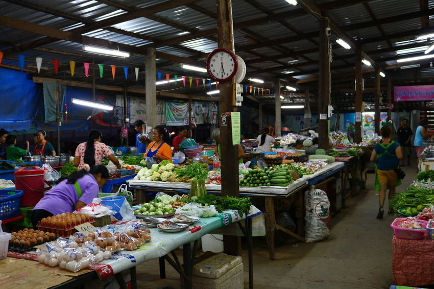 NongKhai,ThaiLand Adults Only Choice Country Life Countryside Day Eating Food Food And Drink Freshness Group Of People Healthy Eating Indoors  Large Group Of People Lifestyles Market Market Stall Men People Real People Retail  Sitting Still Still Life Women