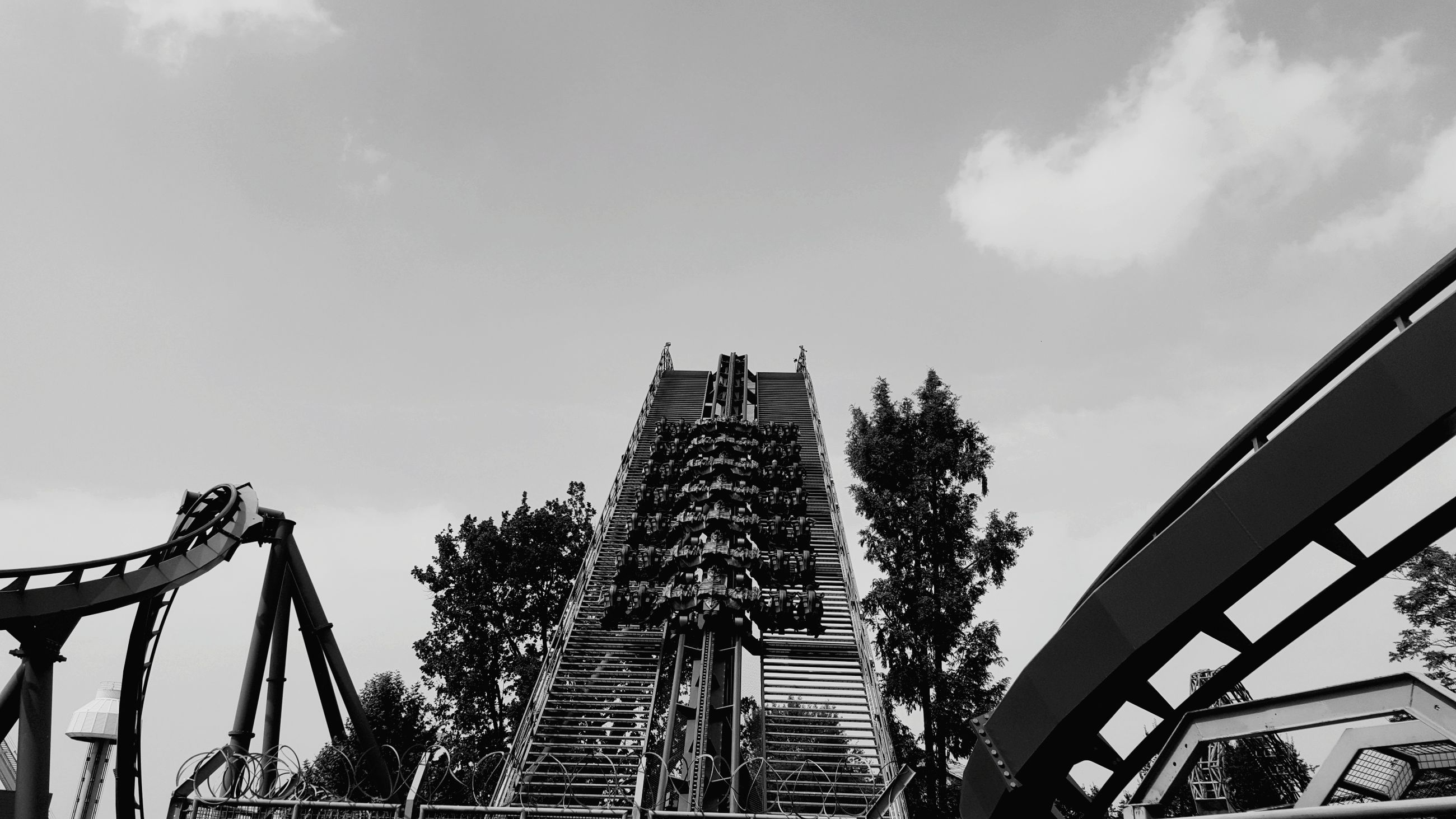 low angle view, built structure, architecture, sky, travel destinations, amusement park, religion, outdoors, day, spirituality, arts culture and entertainment, building exterior, no people, tree