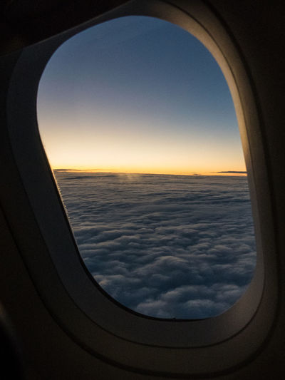 Aerial View Air Vehicle Airplane Airplane Window Boing Clear Sky Clouds And Sky Dawn Flying Frame Framed Lens Flare Nature Orange Scenics Sky Sun Sunrise Transportation Travel Window