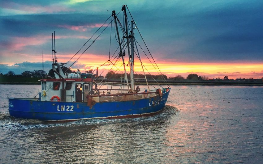 Fishing boat heading out of King's Lynn as the sun sets over the River Great Ouse. Nautical Vessel Sunset Boat Outdoors Cloud - Sky Norfolk King's Lynn East Anglia River Fishing Boat Work IPhone Dusk Tranquility Scenics