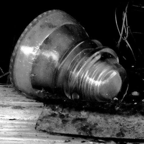 Close-up of old light bulb against black background