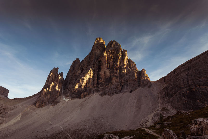 Wooden sculpture depicting a marmot in front of the last ray of sunlight that illuminates the tip of a magnificent dolomitic peak, South Tyrol, Italy Dolomiten Dolomites Dolomiti Unesco Alpine Alps Amazing Beautiful Blue Clouds Dolomite Europe Grass Green High Hiking Holiday Italian Italy Landmark Landscape Meadow Mountain Mountains Natural Nature Outdoor Outdoors Panorama Path Peak Pinnacles Ridge Rock Scenery Scenic Sky South Tyrol Sport Stone Summer Sun Sunny Tourism Travel Trekking Vacation Valley View The Great Outdoors - 2019 EyeEm Awards