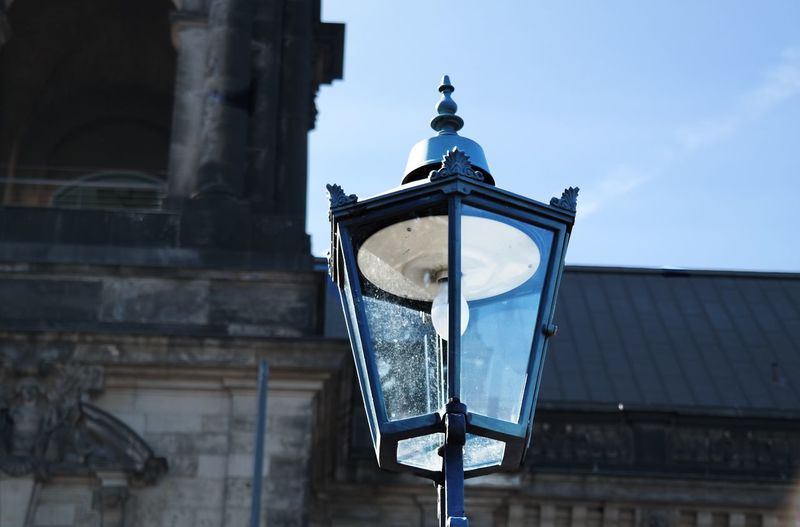 sunlight enlights street light Built Structure Building Exterior Low Angle View Architecture Lighting Equipment No People Outdoors Place Of Worship Spirituality Religion Day Illuminated Sky Street Light EyeEm Best Shots EyeEm Gallery